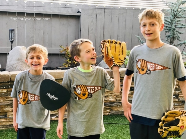 Happy baseball boys with their new shirts from their baseball subscription box!  The BEST GIFT EVER for Baseball Lovers (plus a $20 off coupon) - seriously the coolest and the easiest gift idea for baseball lovers and players!  A surprise box full of baseball gear, apparel, training aids, accessories, and snacks - what's not to love?!  #baseballgiftideas #baseballmom