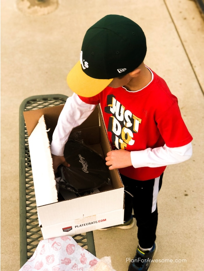 This is seriously the coolest gift my son has gotten!  A surprise box full of baseball gear, apparel, training aids, accessories, and snacks - what's not to love?! #baseballgiftideas #baseballmom